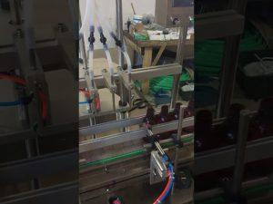Máquina de llenado de líquidos de botella pequeña de 4 cabezas
