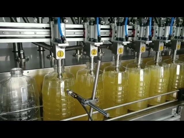 máquina automática de llenado de aceite lubricante con bomba peristáltica