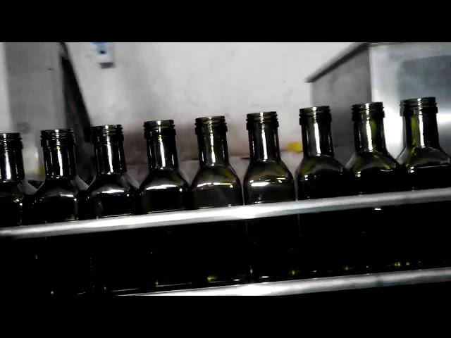 Llenadora de botellas de aceite lineal automática de 6 boquillas de aceite de oliva